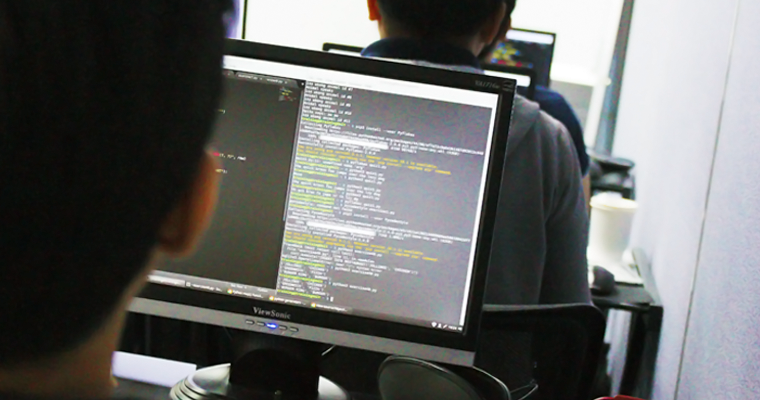 Computer monitor showing source code | DevOps Training Philippines | Orange and Bronze Software Labs