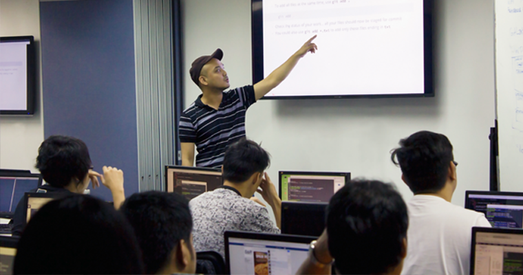 O&B instructor pointed to the big screen explained about reviewing changes before committing on GIt. | Git Training Philippines